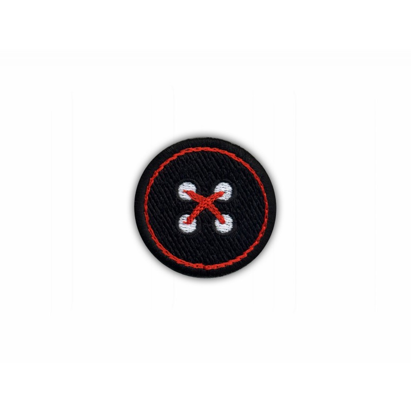Black button with red thread